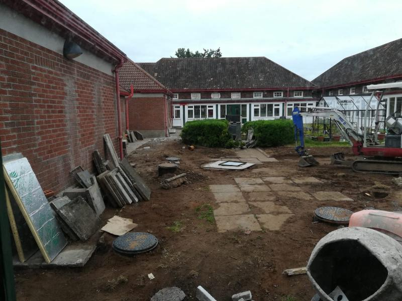 Garden area. New tanks in ground to accommodate new toilet facilty.